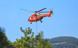 Muğla'nın kırmızı helikopteri 4 günde 322 kez su bıraktı